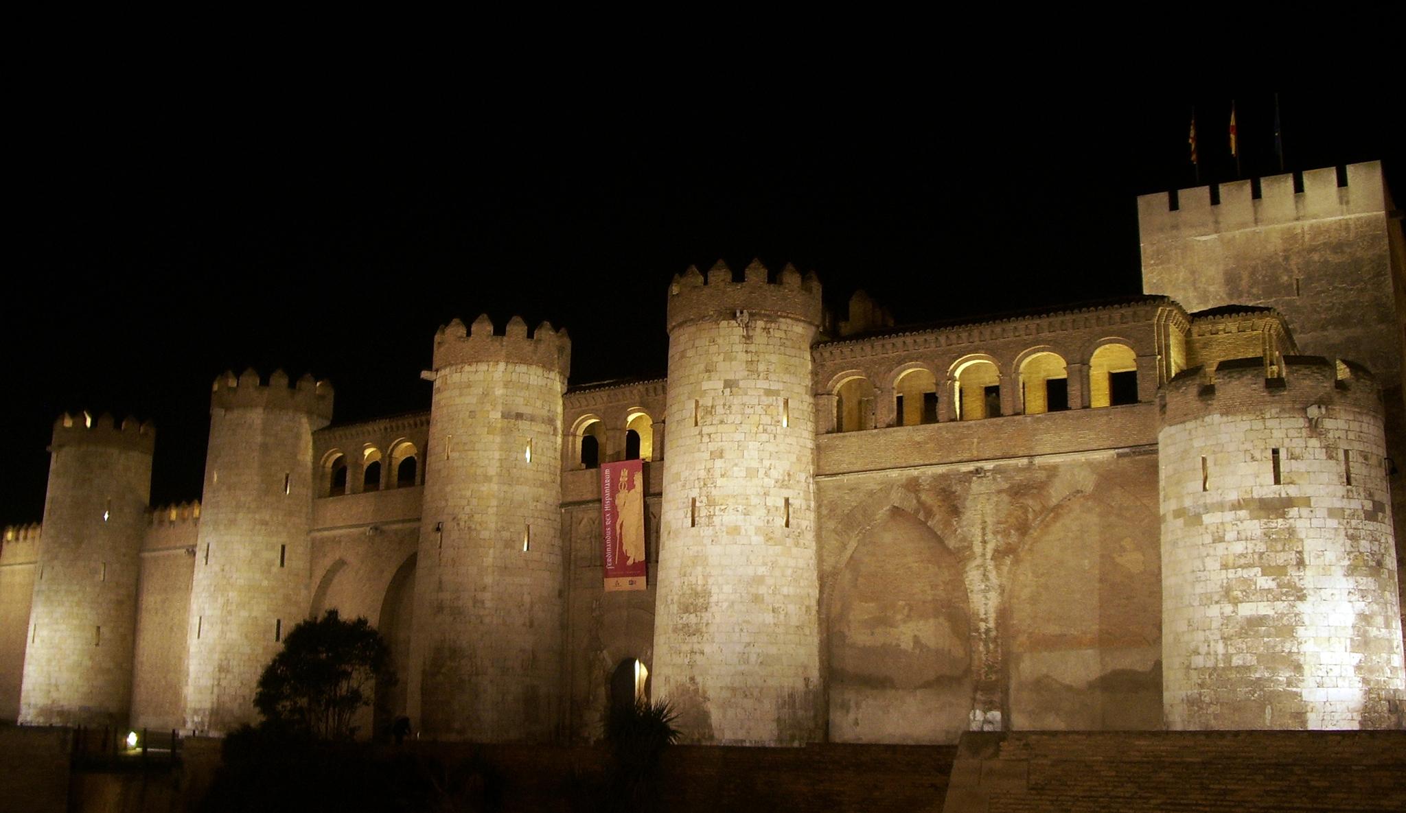 Palacio de la Aljafería en Zaragoza, en donde comienza la obra y el primer acto.